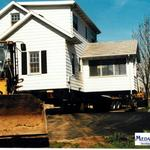 Transported Liberty Bible Church's mission house to a new location and built a new foundation