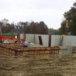 Medallion Developers employees hard at work on a concrete foundation for a home basement