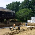 Transporting a home onto a custom built new foundation with a basment