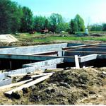 Concrete block foundation with steel beams