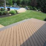 Two-tone Trex composite decking featured on this beautiful backyard deck.