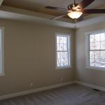 """The Lorraine"" master bedroom featuring tray ceilings"