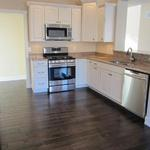 """The Lorraine"" kitchen with custom cabinets and stainless steel appliances"