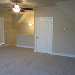 """The Lorraine"" upstairs finished bonus room with doors leading to additional space to finish"